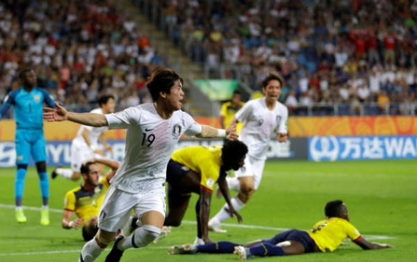South Korea's Choi Jun celebrates after scoring his side's opening goal during the semi final match between Ecuador and South Korea at the U20 World Cup soccer in Lublin, Poland, Tuesday, June 11, 2019. (AP Photo/Sergei Grits)